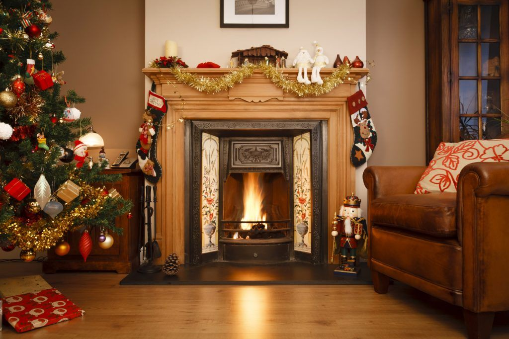 Decorated fireplace in a family home with Christmas tree