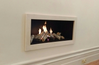 Limestone hole in the wall fireplace