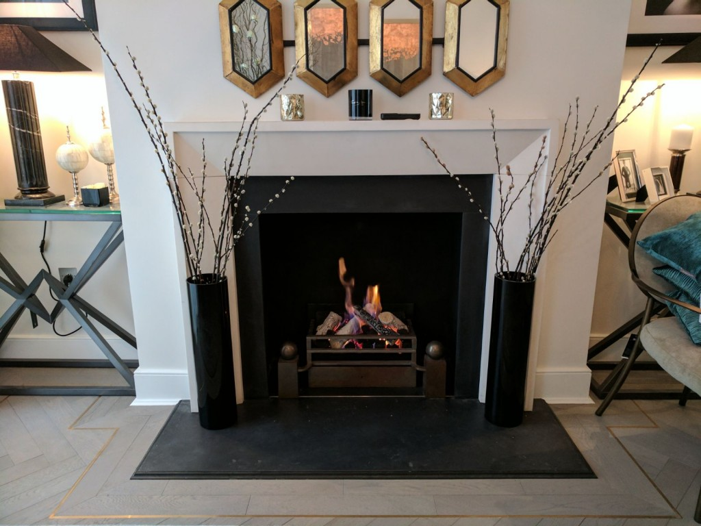 Fireplace surrounded by ornamental pieces