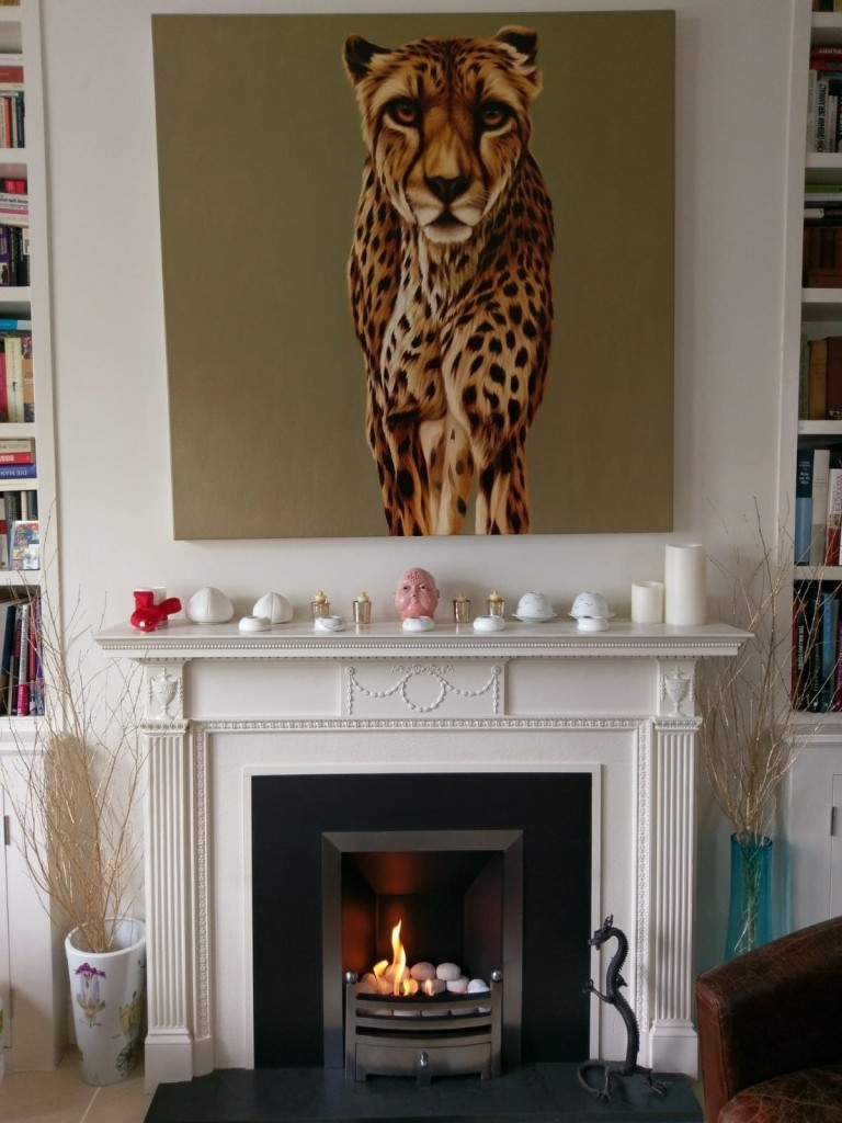A simple yet effective piece of canvas art above a fireplace