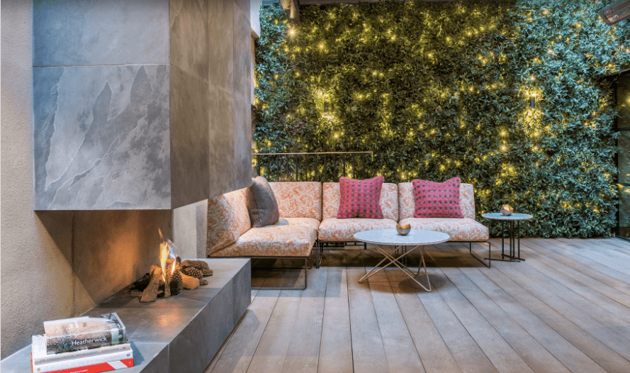 Outdoor gas fire used in a chic and sophisticated courtyard area