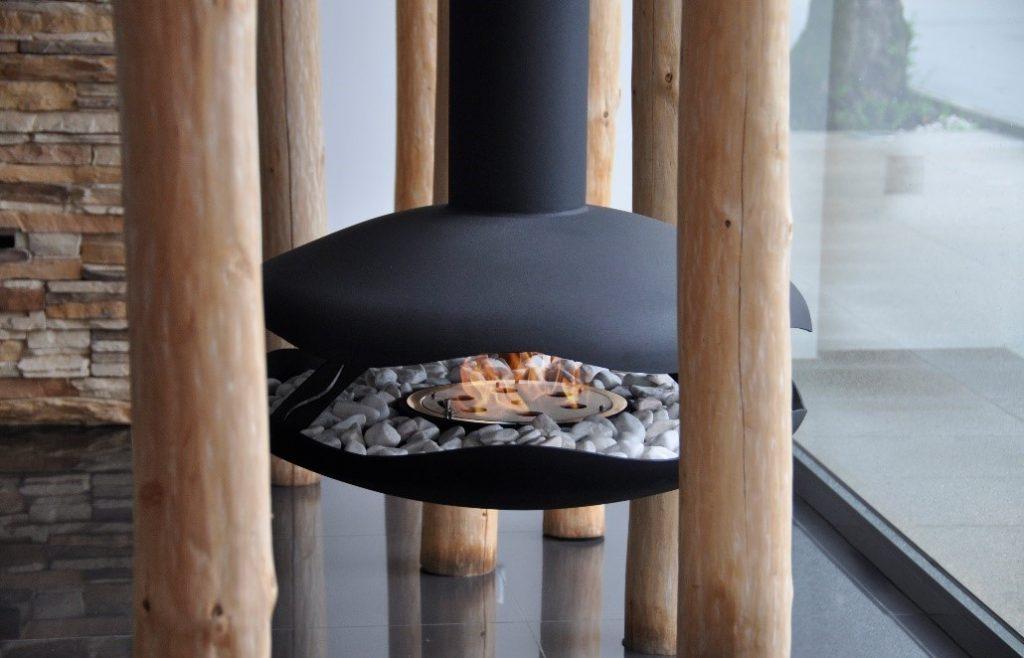 GlammFire Burner inbetween a wooden rustic display