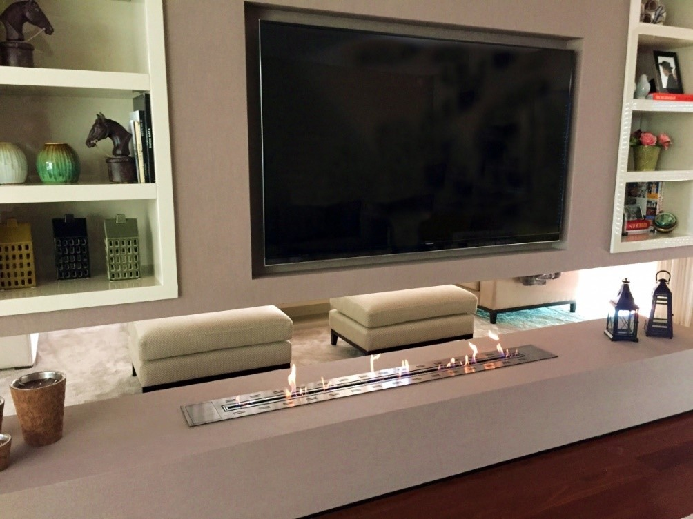 TV Lounge Area With a Partition Displaying a Bioethanol Burner