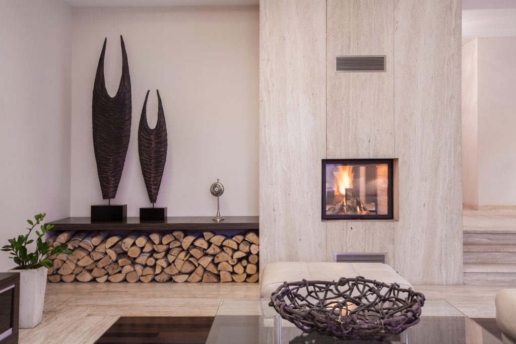 Modern fireplace with wood in the living room