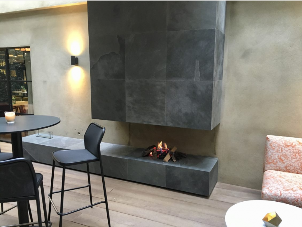 a real flame installed corner fireplace
